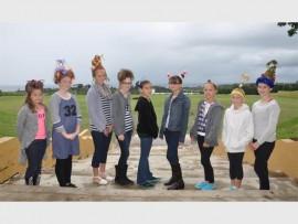 Southcity Preparatory pupils (from left) Jennifer-Rose Douglas, Paige Arthur, Sarah-Joy Pringle, Paige Elliott, Charlize du Plessis, Taylor Ferreira, Amy Botha, Megan Jamieson and Ella Drummond were selected as class winners in the 'crazy hair' day.