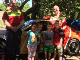 Peeking inside: Jacob and Belinda Catchpole from KZN Private Ambulance Service visited Fantasia Nursery School to the delight of pupils (from left) Emba Burne, 'JP' Pretorius, Justin Howell and Seth Pieterse who are learning all about hospitals.