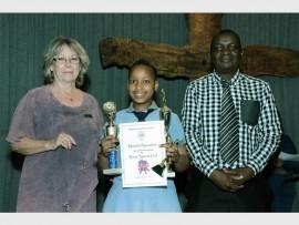 Worthy recipient: Hlanganani Preparatory principal Elaine Galanakis and HOD Kudakwashe Zditameo congratulate hardworking gr 7 dux awardee Mamela Nyandeni.