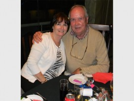 Christmas spirit: June and Martin Rundle relax at their table. SUBMITTED