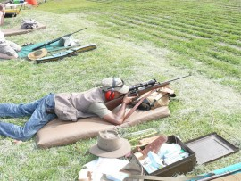 Taking aim: Desmond Govender gets in some rifle shooting.