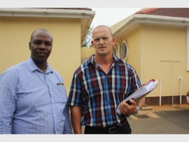 Warrant Officers, Peter Motsoeneng (left) and Johan Boshoff, of the Family Violence, Child Protection and Sexual Offences (FCS) provincial head office, Gauteng, who investigated the case.