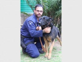 Best friends: Warrant Officer Rommel da Rosa from the Search and Rescue Unit in Port Shepstone with his new best friend, Bear, who was handed over to him by Lieutenant Jack Haskins from Pietermaritzburg. 3412SN