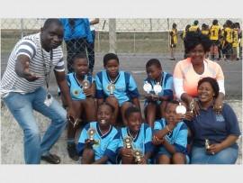 Winning team: Hlanganani HOD Kudakwashe Zvitambo (left) and teachers Zamanyambose Mbasha (back right) and Precious Cele (front right) were extremely proud of the U12 girls' volleyball team (back, from left) Anelisa Mqadi, Luleka Nhleko, Amahle Nzimande, (front) Aviwe Mpekwana, Nompumelelo Majola and Amahle Cele for reaching the final and winning their match last week.