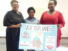 Top entry: Merlewood Primary teacher Sharleen Robertson (left) and programme director Yonela Ndamase (right) congratulate Bathabile Khusi for her winning poster about hygiene.