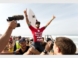 Pure joy: Brazilian surfer, Alejo Muniz is lifted up in celebration of his 2015 Ballito Pro victory that consolidated his lead in the QS rankings, earning him a coveted spot in the 2016 Championship Tour.