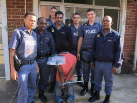 Seen with the suspect are (from left) Student Constable Matthew King, Warrant Officer 'PC' Naicker, W/O Johan Terreblanche, Cst Ashley Ramsingh, Std Cst Wynand Prinsloo, Std Cst Donovan Horne and Captain 'DC' Mkhize.
