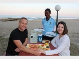 Penelope Mpisane serves Jason Watt and Lauren Rushton.