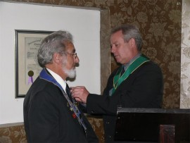 Lion President Steve Coulson (left) receives his badge of office from Zone Chairman, Jeff Smith.
