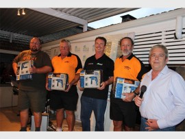 Winning the Wozani Berg Gasoline golf day at Port Shepstone Country Club were (from left) Marius D'Alton, Nic van Deventer, Gordon D'Alton and Dries Barkhuizen of team All Plant Tool Hire. Glen Smit does the honours.