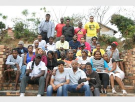 Dinesh Pillay (top, left), with the locals who will be involved in the rollout of compact fluorescent lights (CFL) in the residential sectors of Marburg, Merlewood and Hlanganani. 7809vee