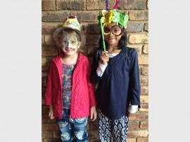 Party time: Izotsha Primary gr 1 pupils Abigail Scaife (left) and Hana Asmal had a lot of fun celebrating 100 days of being at school.