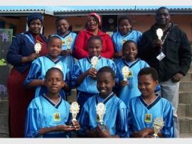 Praiseworthy performance: Hlanganani Preparatory teachers Zamanyambose Ruth Mbasha (back, left), Precious Cele (middle) HOD Kudakwashe Zvitambo (right) were very impressed with the U12 girls' volleyball team comprising (back, from left) Amahle Nzimande, Luleka Nhleko, (middle) Amahle Cele, Zamakhize Mkize, Nompumelelo Majola, (front) Ntandoyenkosi Ngcobo, Aviwe Mpekwane and Thandiwe Khonzaphi, who emerged victorious at the final schools' volleyball tournament last week.