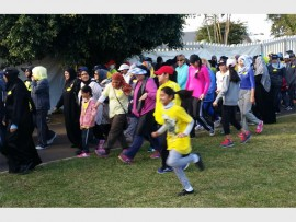 On your marks: Eager and energetic walkers start the women's fun walk held at PSIS last weekend.