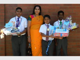 Exemplary effort: RA Engar principal Dr Mala Appalraju congratulates pupils (from left) Kaelyn Ramalingam, Mohammed Osman and Kriven Govender, who were rewarded for raising the most money at their sponsored fun walk held recently.