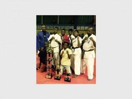 Improving: Showing off their trophies at the Shihan Sabela Memorial tournament are South Coast karateka (back, from left) Sensei Dr Sipho Nzimande, Senpei Sfiso Nhlumayo, Senpei Themba Mbili, Senpei Thabiso Gwebela, Senpei Nonku Bhengu, Senpei Bongani Madlala; (front) Senpei Thokozani Shabane and Senpei Sfiso Shusha.