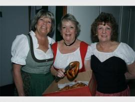 German flair: Enjoying the evening were (from left) Yvonne Bausek, Merle Davies and Lenie Geyer of Margate. 2828vee