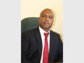 Show support: Local human rights activist and a member of the Active Citizens' Movement (interim committee), Selvan Chetty has thrown his weight behind Finance Minister Pravin Gordhan who faces charges of fraud and theft. 7001SN