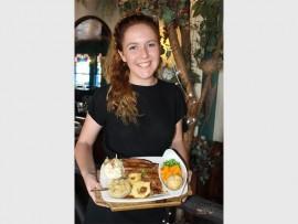 Amy Jordaan from Friar Tuck Restaurant serves the Robin Hood rump steak, a firm favourite.