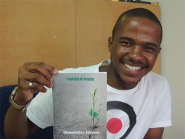 Poet Sifundokuhle L Kweyama with a copy of his poetry volume, 'Flowers of Africa'.