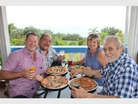Enjoying good food, good company and good times are Leon Engelbrecht (left), Derek Morgan, Jeanne Gregori and Roland Morgan.
