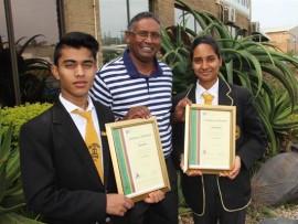 Principal of Port Shepstone Secondary Genganathan Odayar congratulates the school's two top pupils, Shiven Chetty and Karosa Moodley.