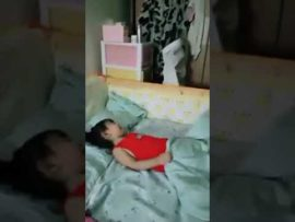 Little girl pretends to sleepwalk