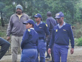 Station commander, Brigadier Boxer Pillay with the members of the Crime Prevention unit raiding illegal shebeens in the Copesville area shortly after two murders