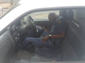 The picture taken by Ben Heydenrych and posted on Facebook of a police constable from the Mid-Illovo police station, allegedly asleep, with an alcohol bottle between his legs, in a police van in Pietermaritzburg.