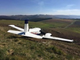 Slightly damaged plane following an emergency landing on a Hilton farm