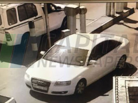 A picture of the white Audi that was used in the robbery seen leaving the mall's parking lot