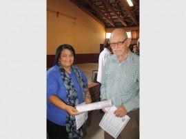 LifeLine Zululand representative Sandra Adams hands out awareness flyers to senior citizen Rui da Fonseca