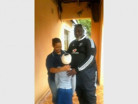 Community workers -Sharon Mdletshe and Pastor Sithole with the child who was severely beaten