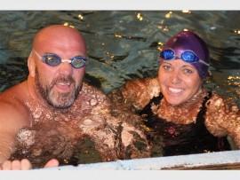 Barry and Bridget Picton take a  breather during the marathon all night swim PHOTOS: Debbie Lane
