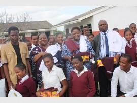 At the handover of school uniforms are (back) CES for uMhlathuze Senzo Dube, uThungulu Deputy Mayor Nonhle Mkhulisi, uMhlathuze Cllr Khululiwe Mbonambi and school Principal Sibusiso Mpanza. In front are some of the recipients - Nontobeko Sabela, Nokwanda Phiri, Nonhlahla Phoseka and Sizwe Ngobe