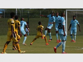 Siyabonga Bengu (26) leaps highest to make a defensive clearance