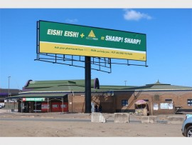 This large billboard erected at the Richards Bay taxi rank on Bullion Boulevardwas illegally erected, and the City is in the process of dismantling it  Photo - Dave Savides