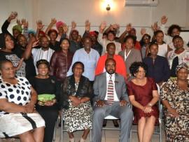 Jubilant widows with Ukhozi FM's Themba Khumalo, Pastor T Ngonelo, uMfolozi Deputy Mayor Gogo Ntshangase, Mayor KE Gamede, Prof Q Mkhabela and widows' chairperson M Khumalo  PHOTO: Steven Makhanya