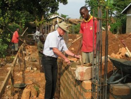 One of the SES senior experts offering training in construction to a keen observer