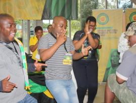 Youth League Provincial Secretary Thanduxolo Sabela (centre) leading a revolutionary song