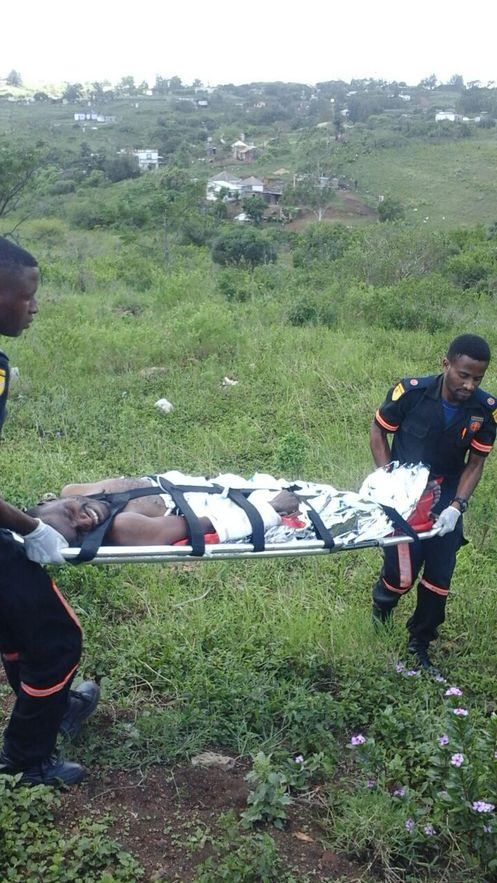 An injured suspect is treated by paramedics after a fierce shootout with police. He later died on his way to hospital