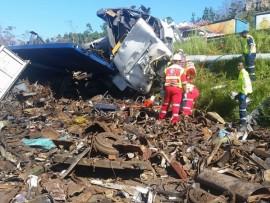 Truck overturns killing one, injuring two (Custom)