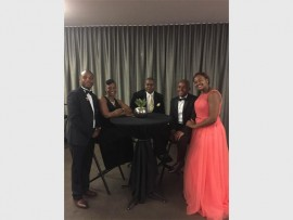 Henry Rose Event Company's project manager Tebogo Bulane (left) with attendees at the Annual Black Tie Charity Gala Dinner in 2014.