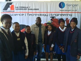 Aurora Girls High Schools pupils with a teacher, Pule Kgaboe, at the launch.