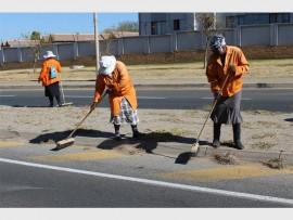 Community Works Programme volunteers clean up streets in Midrand.