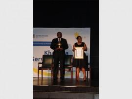 Gauteng Premier David Makhura presents the awards with Health MEC Qedani Mahlangu