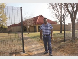 Cllr Matthew Shunmugam at Lennoxton Library where the fencing project has finally begun.