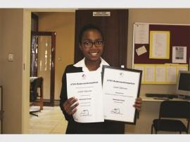 Sanele Skhosana proudly holds her certificate she won at the ' ATKV Redenaarskompetisie'.