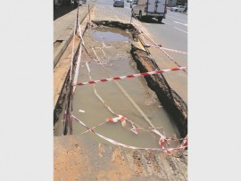 The aftermath of an underground pipe bursting on Murchison Street.