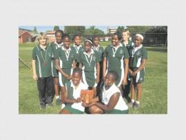 u/13 - Front: Ntando Sithebe and Olwethu Sikhosana. Middle: Avukile Nkosi, Nosipho Mchunu, Minenhle Nkosi and Aphelele Mhlanga. Back: Virginia Stonell (coach), Bandile Olih, Amahle Ntuli, Luyanda Mndaweni and Susan Brink (coach).